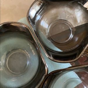 Three smoked glass charcoal colored bowls
